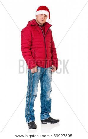 Full length portrait of a young man dressed with winter clothes and Santa hat isolated on white background