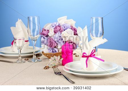 Table setting in purple tones on color  background