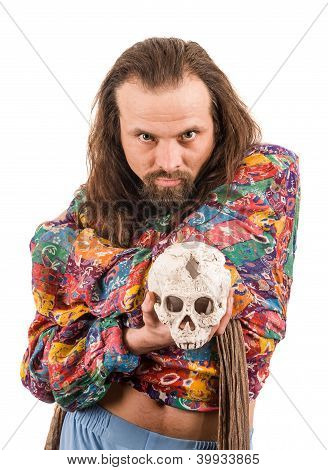 The Bearded Man In The Colour Shirt With A Skull In His Hands