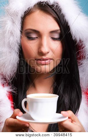 Beautiful Girl Santa Claus Girl Blowing Hot Drink
