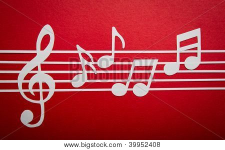 Paper  cut of music note on staves with copy space for text or design
