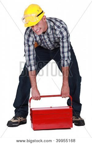 laborer lifting heavy toolbox