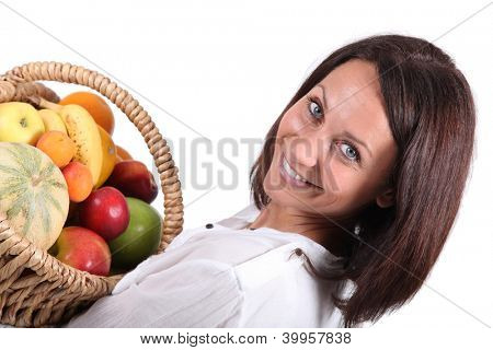 woman holding a fruits basket