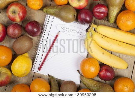 Pencil on book amidst fruits