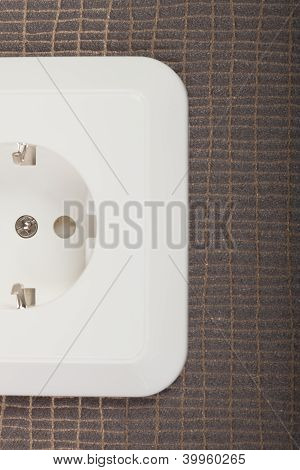 Outlet on textured background