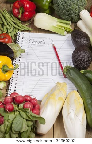 Book surrounded with vegetables