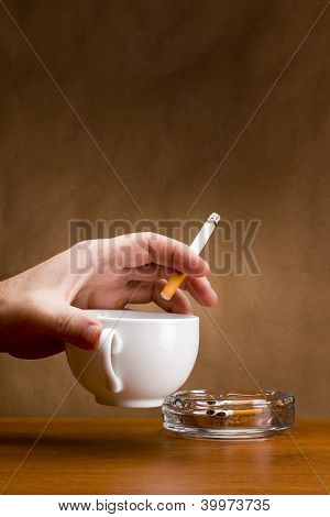 Hand Holding A Cigarette