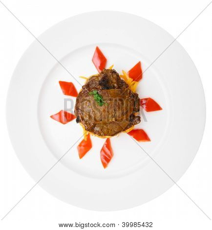 Fried venison in porcelain plate, isolated on black background