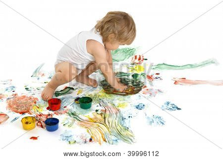 happy boy playing with paint