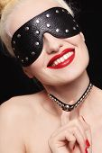 image of blinders  - Portrait of young beautiful smiling woman in studded blindfold and collar - JPG