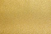 foto of gold-dust  - glitter sparkles dust on background - JPG