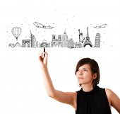 Young woman drawing famous cities and landmarks on whiteboard isolated on white poster