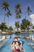 Family Vacation In Tropical Beach