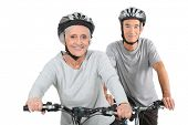 picture of 55-60 years old  - Elderly couple cycling - JPG