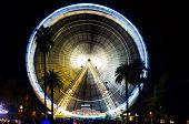 stock photo of dizziness  - Abstract view of a carnival ferris wheel at night - JPG
