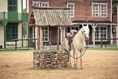picture of gunfighter  - hourse at the Historic wild west town style - JPG