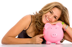 image of save money  - casual woman looking to save money in a piggy bank - JPG