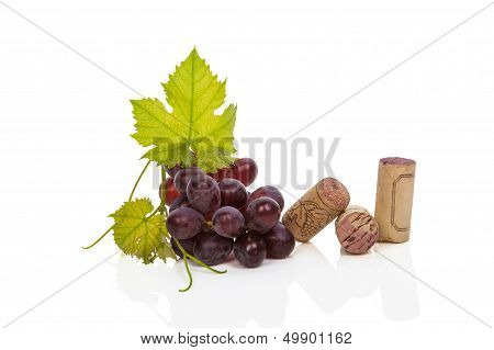 Wine Corks, Vine Leafes And Red Grapes.