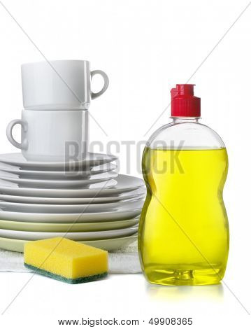Bottle of dishwashing liquid and stack of utensils isolated on white
