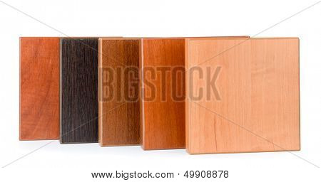 Row of samples of  stained wood for furniture isolated on white