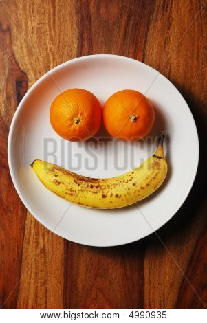 Fruit Arranged As Happy Face On A White Plate