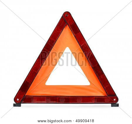 Red reflecting traffic warning triangle isolated on white