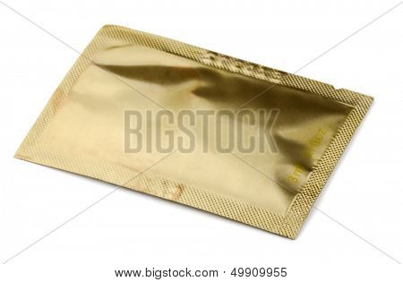 Golden small cosmetics  sachet   isolated on white