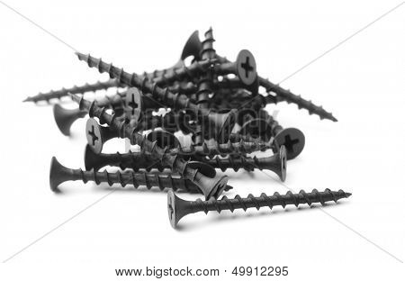 Black drywall screws isolated on white