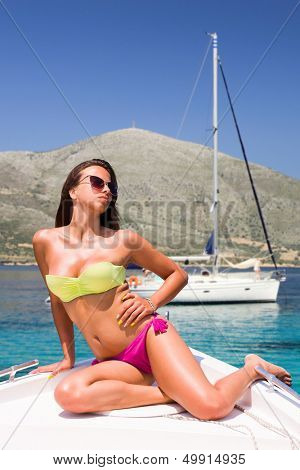 Young sexy woman a speed boat at sea