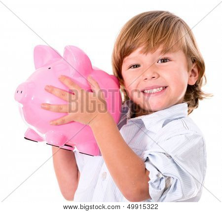 Happy boy holding a piggybank - isolated over a white background
