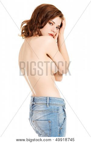 Beautiful fit sexy topless woman in blue jeans, isolated on white background