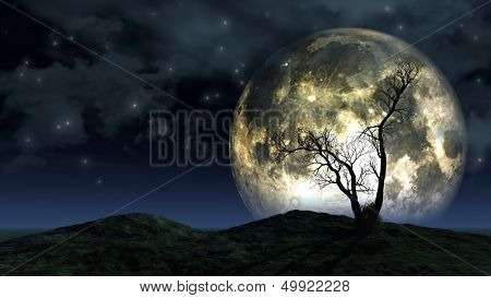Spooky silhouette of a tree against a large moon in a night sky