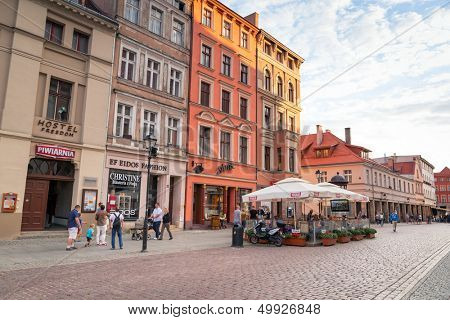 TORUN, POLAND - AUG 15: Unidentified people walking on the old town of Torun - 15 of August 2013. Torun is one of the oldest cities in Poland and the birthplace of the astronomer Nicolaus Copernicus.