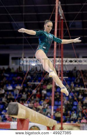 KIEV, UKRAINE - MARCH 31: Aliya Mustafina, Russia performs routine on balance beam during International Tournament in Artistic Gymnastics Stella Zakharova Cup in Kiev, Ukraine on March 31, 2013