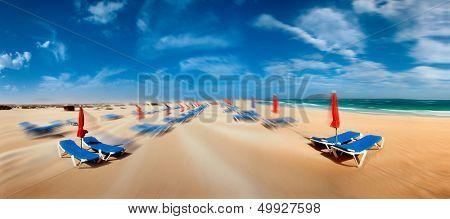 Sunshade and sunbed on sand beach Fuerteventura island, Spain
