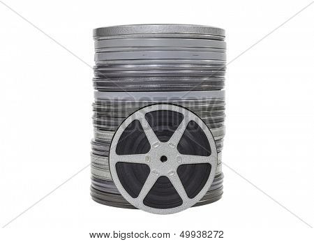 Vintage home movie film cans and reel isolated.