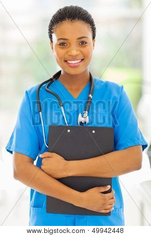 beautiful female african medical nurse holding clipboard