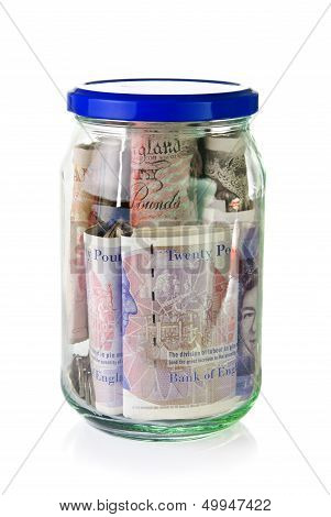 British Pounds Banknotes In A Glass Jar