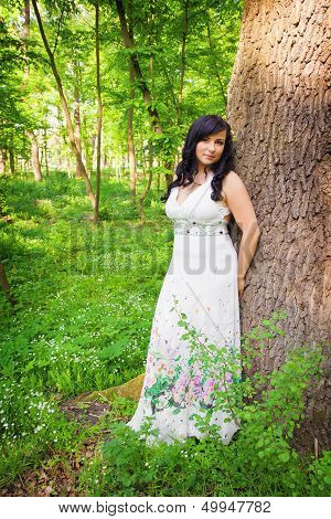 Romantic Woman In Summer Forest