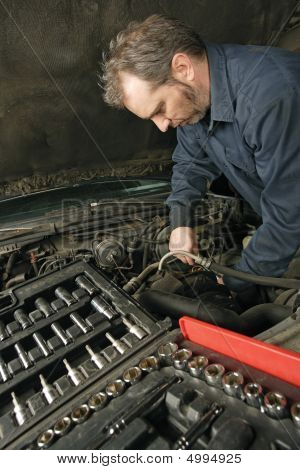Mechanic Repairing An Engine
