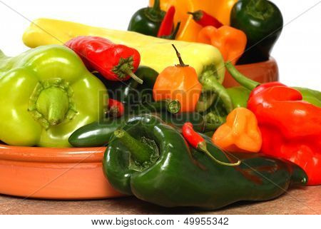 Variety of brightly colored peppers and chilies.