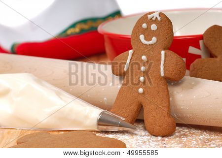 Kitchen scene showing the making and decorating of Christmas gingerbread men.