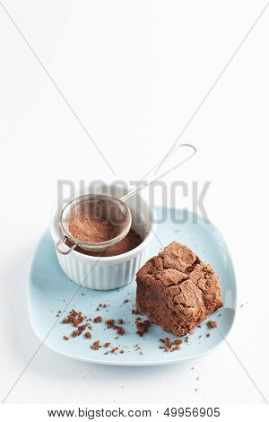 Chocolate Brownie On Plate Served With Cocoa Powder