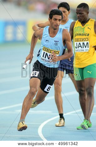 BARCELONA - JULY, 14: Jeevan Karekoppa Suresh of India competes on 4X400 Relay of the 20th World Junior Athletics Championships at the Olympic Stadium on July 14, 2012 in Barcelona, Spain