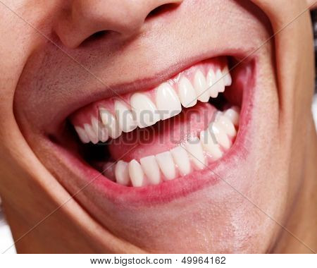 Close up shot of awesome healthy teeth smile over white background