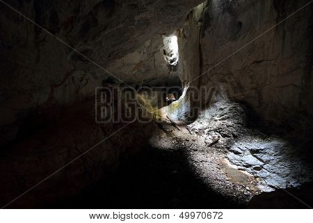 Tourists in the Occidental Carpathians, Radesei Cave, Romania