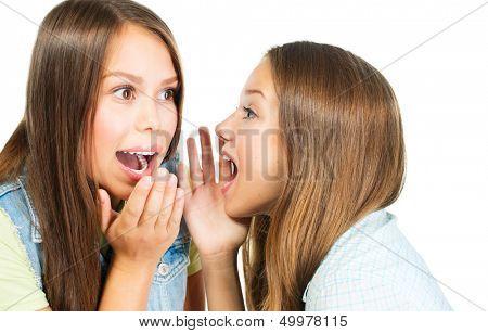 Gossip. Two Teenage Girls Speaking and Sharing Secrets. Whispering Girlfriends