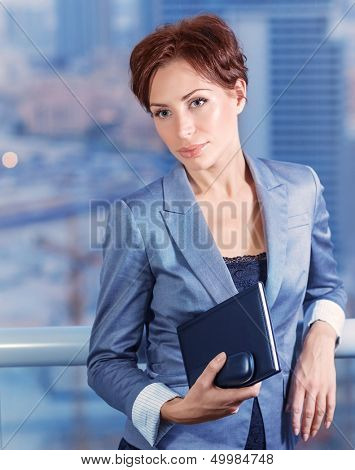 Businesswoman on the meeting, attractive serious female waiting for a business partners, big boss in financial corporation, good job concept