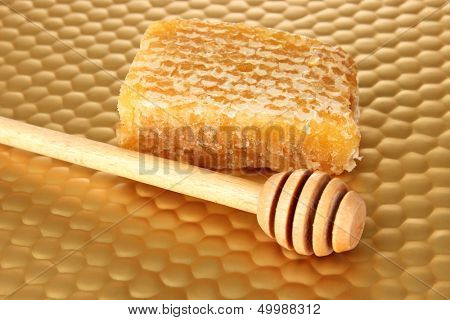 Honey comb and honey on bright yellow background