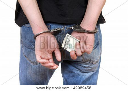 Handcuffs In Hands With Money